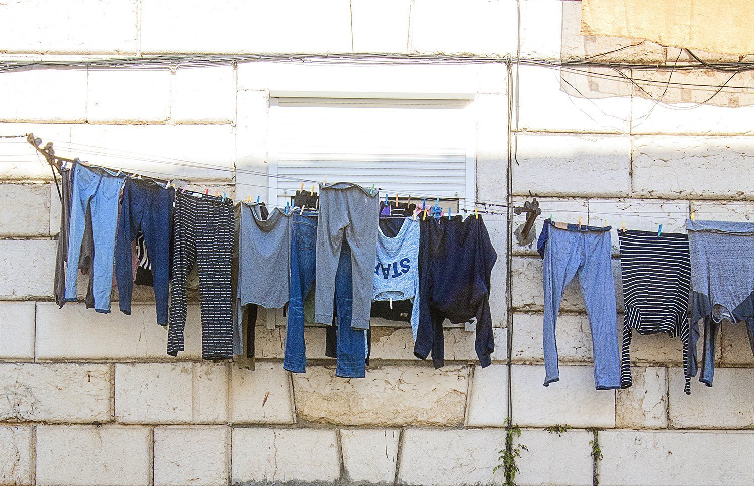 Hanging laundry outside a Portugal apartment.